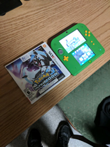 Nintendo 2DS with ocarina of time and pokemon ultramoon