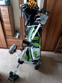 Left handed golf clubs with bag and trolley
