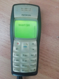 Old Nokia 1100 Grey/silver.