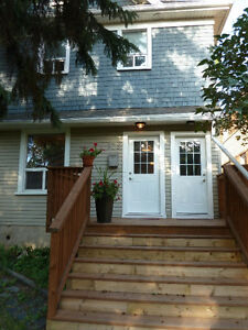 One Bedroom plus den - steps from corydon near rapid transit