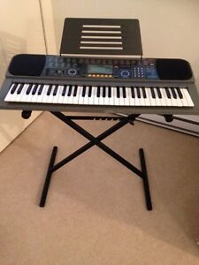Casio keyboard with stand and power adapter
