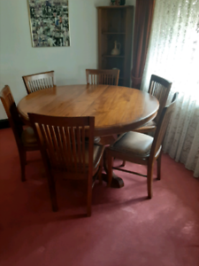 Beautiful old timber and leather chairs and round table seats six