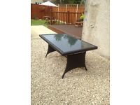Rattan garden table brown with glass top