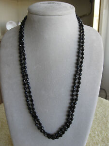 LONG 27-INCH OCTAGONAL-SHAPED JET-BLACK GLASS BEADS....