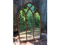 Wood effect gothic style mirror