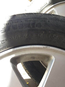 4 used Nissan tires with rims
