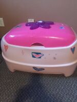 Barbie toy box and little fridge.