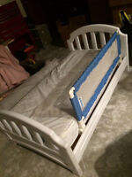 Toddler bed with mattress and safety bar