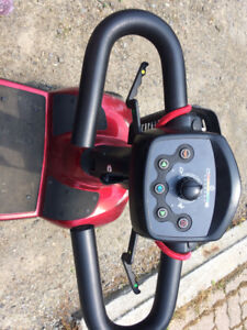 In a are 4 wheel scooter. GUC