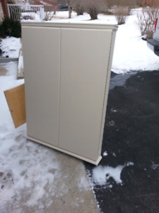 Cabinet with white board inside