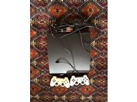 PlayStation 3 with 2 controllers and cable