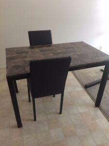 Sturdy table with two chairs for sale