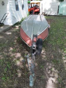 12 foot am boat. 9.9 mercury