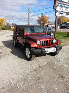 2009 Jeep  4 Door 6 speed manual, 2 tops ready for summer fun