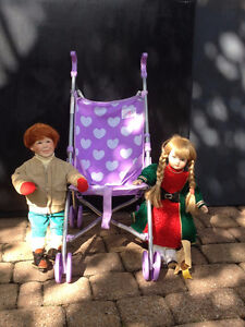 Toy stroller with 2 procelain dolls