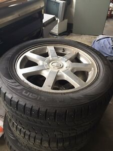 255/55/18 all weather tires on Cadillac rims