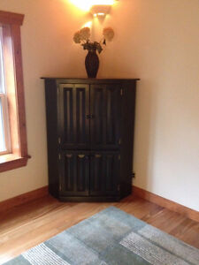 SOLID WOOD 6 DOOR CORNER TV UNIT WITH ADJ. SHELVING.  MINT; $200