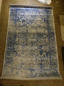 Brand new, never used 3x5 blue and silver area rug