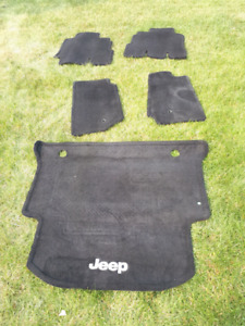 Factory Jeep Wrangler carpeted floor mats and cargo liner