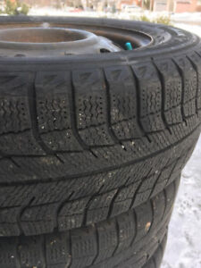 4 Winter Tires and Rims 185 65 R14 off a Toyota Yaris
