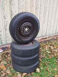 """Brand new 14"""" snow tires 195/75/14. with rims"""