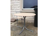 Bistro style table and one chair