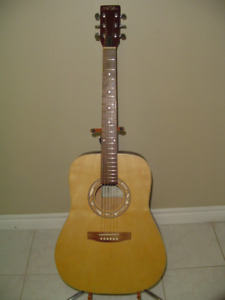One Classy folk guitar, with padded bag