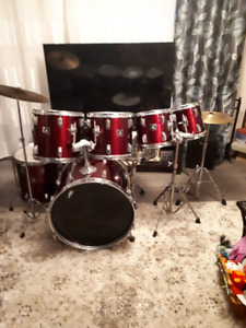 Tama 7 pc. (made in Japan!), Paiste cymbals, hardware.