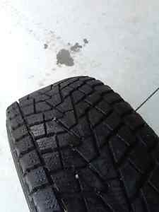 215/70/15 Bridgestone Winter Tires & 15x6.5 Ford Alloy Rims Belleville Belleville Area image 3