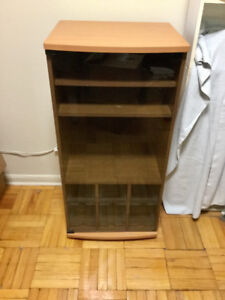 IKEA wooden cabinet with a glass door.