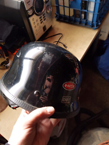 2 Motorcycle helmets and a Pair of gloves