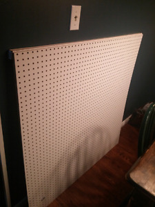 Two 4'x4' peg boards with hooks