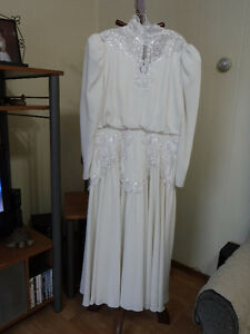 Off white long sleeved dress with white lace, beads and sequins
