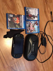 PS Vita system with 3 games and case