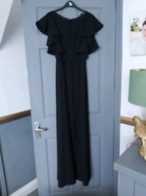 2 black evening dresses and faux fur Black tie wrap