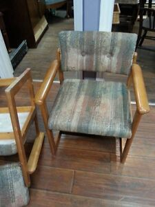 pair of covered wood chairs