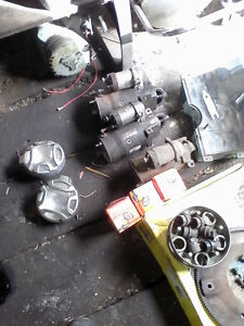 various sbc parts, headers, flywheel, starters gauge assembly