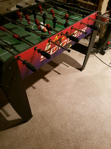 Foosball table with balls.