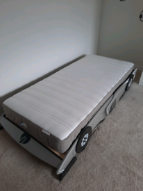 Silver and black single car bed