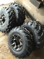 4 fairly new rims an tires off Canam renegade