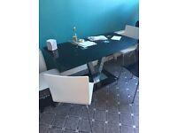 Corfu black glass dining room table - worth £349!