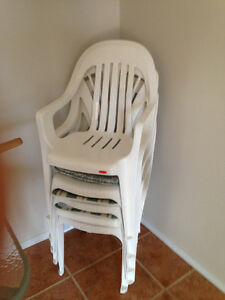 STACK OF 7 CHAIRS WITH CUSHIONS