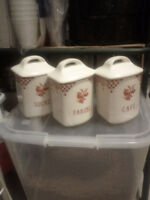 Three decorative white and red canisters. Picture.