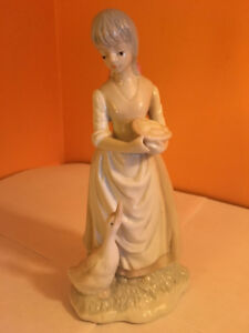 Porcelain Lady Figurine with a Duck