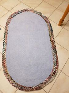 Blue Braided rug with accent edges