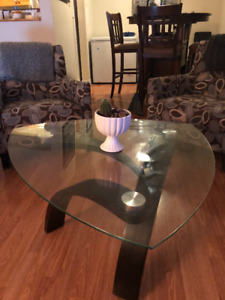 Glass coffee table with dark wooden legs
