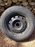 4 Basically brand new winter  tires/steel rims size 185/65/14