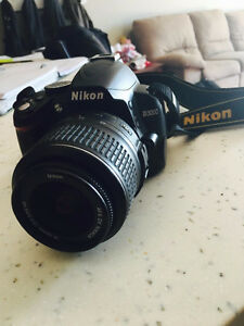 Nikon D3000 + AF-S DX NIKKOR 18-55mm Lens + Camera Bag