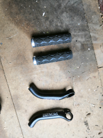 Bar ends and grips for bike.