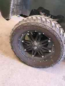 Selling my rims and tires chev or Dodge 8x6.5